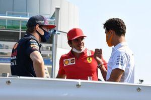 Max Verstappen, Red Bull Racing, Carlos Sainz Jr., Ferrari, and Lando Norris, McLaren, in the drivers parade