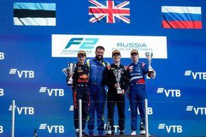 Juri Vips, Hitech Grand Prix, 2nd position, the Carlin team representative, Dan Ticktum, Carlin, 1st position, and Robert Shwartzman, Prema Racing, 3rd position, on the podium