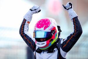 Race winner Alice Powell celebrates in Parc Ferme