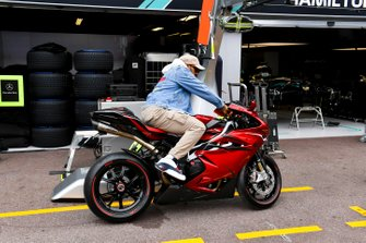 Lewis Hamilton, Mercedes AMG F1 arrives on a motorbike