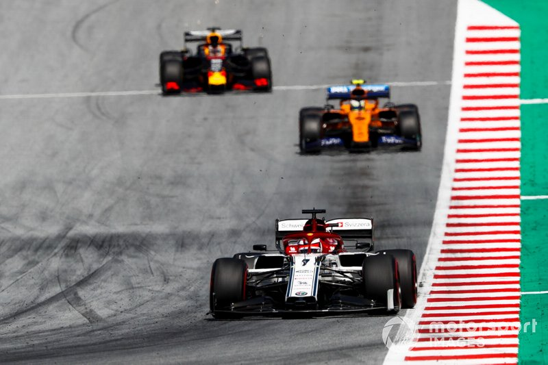 Kimi Raikkonen, Alfa Romeo Racing C38, leads Lando Norris, McLaren MCL34, and Max Verstappen, Red Bull Racing RB15