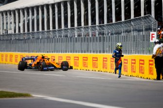 Lando Norris, McLaren MCL34 runs away from his car after retiring from the race