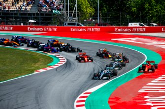 Lewis Hamilton, Mercedes AMG F1 W10, leads Valtteri Bottas, Mercedes AMG W10 into the first corner as Sebastian Vettel, Ferrari SF90 runs wide ahead of Max Verstappen, Red Bull Racing RB15, Charles Leclerc, Ferrari SF90, Pierre Gasly, Red Bull Racing RB15, and the rest of the field