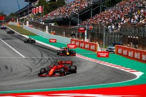 Charles Leclerc, Ferrari SF90, leads Pierre Gasly, Red Bull Racing RB15, and Romain Grosjean, Haas F1 Team VF-19