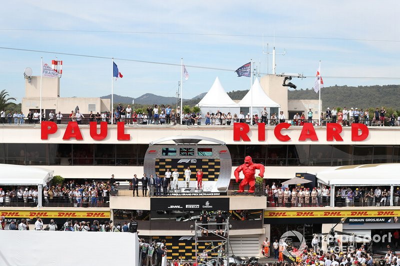 Valtteri Bottas, Mercedes AMG F1, 2nd position, Lewis Hamilton, Mercedes AMG F1, 1st position, and Charles Leclerc, Ferrari, 3rd position, on the podium