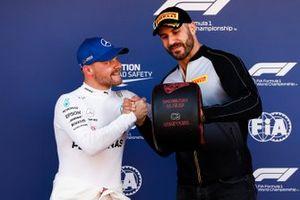 WWE wrestler Cesaro presents Valtteri Bottas, Mercedes AMG F1, with his Pirelli Pole Position award