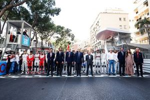 Drivers line up on the start line for the Monegasque national anthem