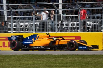 Lando Norris, McLaren MCL34, parks his car and retires from the race