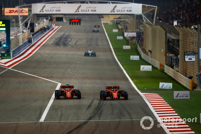 Charles Leclerc, Ferrari SF90, battles with Sebastian Vettel, Ferrari SF90, for the lead