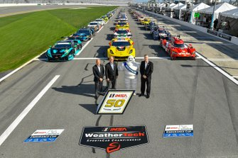 Group picture with all cars and IMSA President Scott Atherton, IMSA Chairman, Jim France and IMSA CEO Ed Bennett