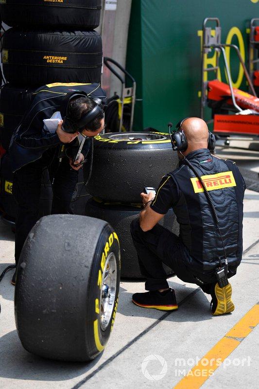 Pirelli technicians examine some tyres
