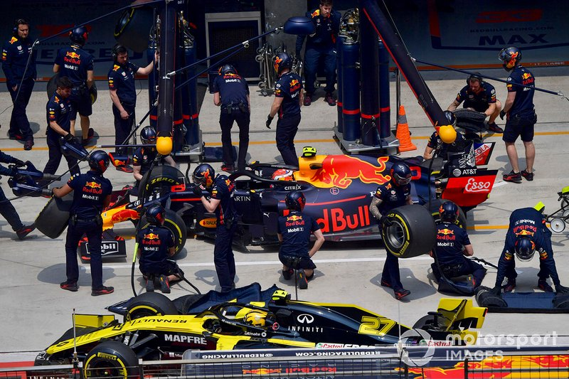 Pierre Gasly, Red Bull Racing RB15, in the pits during practice as Nico Hulkenberg, Renault F1 Team R.S. 19, passes