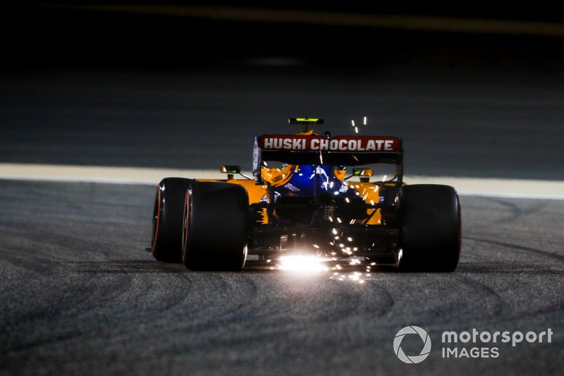 Sparks fly from the rear of Lando Norris, McLaren MCL34