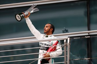 Lewis Hamilton, Mercedes AMG F1, 1st position, with his trophy and Champagne