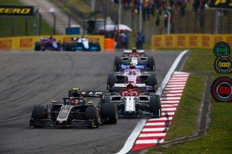 Kevin Magnussen, Haas F1 Team VF-19, leads Kimi Raikkonen, Alfa Romeo Racing C38, Lance Stroll, Racing Point RP19, and Antonio Giovinazzi, Alfa Romeo Racing C38