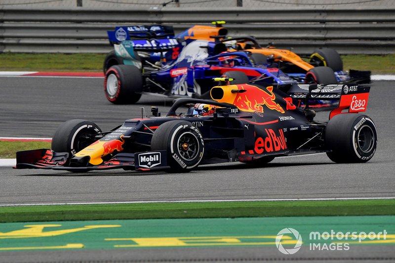 Pierre Gasly, Red Bull Racing RB15, leads Daniil Kvyat, Toro Rosso STR14, and Lando Norris, McLaren MCL34
