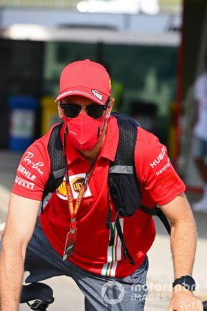 Sebastian Vettel, Ferrari, cycles into the circuit