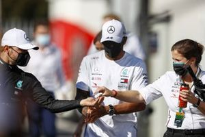 Lewis Hamilton, Mercedes-AMG F1, and Valtteri Bottas, Mercedes-AMG F1, sanitise their hands