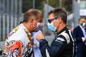 Kai Abel, RTL, talks to Bernd Maylander, Safety Car Driver, FIA, on the grid