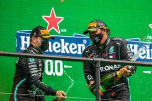 Valtteri Bottas, Mercedes-AMG F1, 2nd position, and Lewis Hamilton, Mercedes-AMG F1, 1st position, celebrate with Champagne on the podium