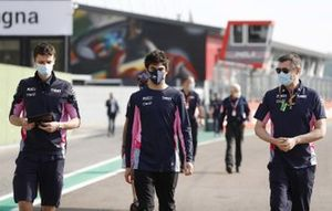 Lance Stroll, Racing Point, walks the track with team mates