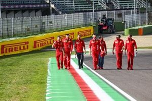 Sebastian Vettel, Ferrari, walks the track with Marc Gene, reserve driver, Ferrari and other team mates