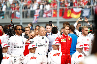 Lewis Hamilton, Mercedes AMG F1, Valtteri Bottas, Mercedes AMG F1, Sebastian Vettel, Ferrari, Kevin Magnussen, Haas F1 Team, and the other drivers join the Grid Kids on the grid prior to the start