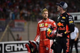 Sebastian Vettel, Ferrari and Max Verstappen, Red Bull Racing celebrate in Parc Ferme