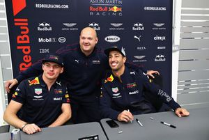 Daniel Ricciardo, Red Bull Racing and Max Verstappen, Red Bull Racing pose for a photo with a Red Bull Racing team member