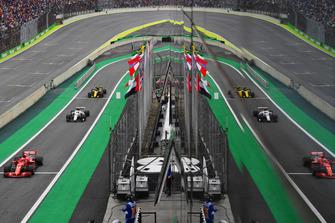Sebastian Vettel, Ferrari SF71H, Charles Leclerc, Sauber C37 and Nico Hulkenberg, Renault Sport F1 Team R.S. 18