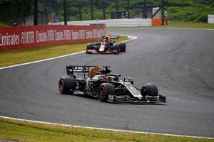Romain Grosjean, Haas F1 Team VF-19, leads Alex Albon, Red Bull RB15