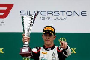 Race winner Leonardo Pulcini, Hitech Grand Prix on the podium with the trophy
