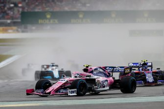 Lance Stroll, Racing Point RP19, leads Alexander Albon, Toro Rosso STR14
