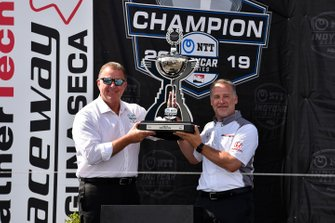 Jay Frye President of IndyCar presents NTT IndyCar Manufacturer's Championship trophy Trophy to Ted Klaus President at Honda Performance Development (HPD)