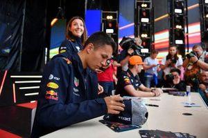 Alex Albon, Red Bull Racing, and Max Verstappen, Red Bull Racing, meet fans