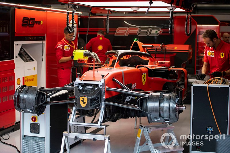 Mechanics work on a Ferrari SF90 in the team's garage at Belgian ...