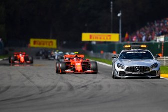 The Safety Car leads Charles Leclerc, Ferrari SF90, and Sebastian Vettel, Ferrari SF90