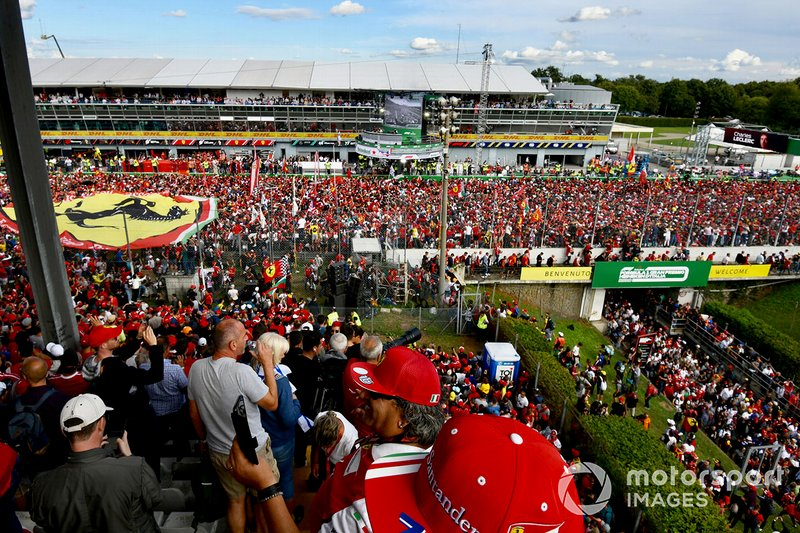 The track becomes a sea of Ferrari fans after the race