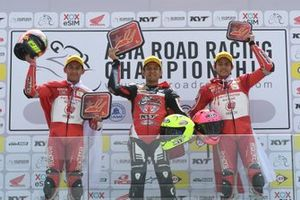 Podium AP250: second place Awhin Sanjaya, Astra Honda Racing Team, Rafid Topan Sucipto, Bike Corner SYS KYT Racing Team, third place Irfan Ardiansyah, Astra Honda Racing Team