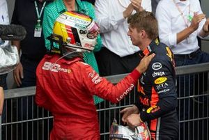 Sebastian Vettel, Ferrari, 2nd position, congratulates Max Verstappen, Red Bull Racing, 1st position, in Parc Ferme