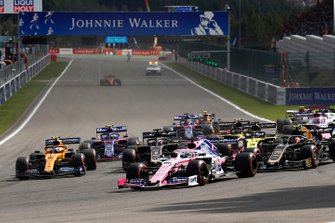 Sergio Perez, Racing Point RP19, leads Kevin Magnussen, Haas F1 Team VF-19, Lando Norris, McLaren MCL34, Romain Grosjean, Haas F1 Team VF-19, Daniel Ricciardo, Renault F1 Team R.S.19, and the remainder of the field at the start