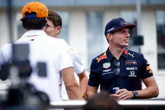 Max Verstappen, Red Bull Racing, Carlos Sainz Jr., McLaren and Lando Norris, McLaren n the drivers parade truck