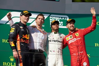 Max Verstappen, Red Bull Racing, 2nd position, James Vowles, Motorsport Strategy Director, Mercedes AMG F1, 1st position, and Sebastian Vettel, Ferrari, 3rd position, on the podium