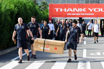 Red Bull Racing mechanics arrive with parts