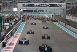 Kevin Magnussen, Haas F1 Team VF-17, leads Lance Stroll, Williams FW40, Romain Grosjean, Haas F1 Team VF-17, and Pierre Gasly, Toro Rosso STR12, on the formation lap