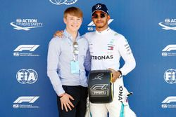 Billy Monger presents pole man Lewis Hamilton, Mercedes AMG F1, with the Pirelli Pole Position Award