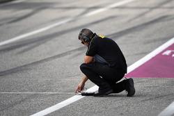 Pirelli engineer checks the track temperature