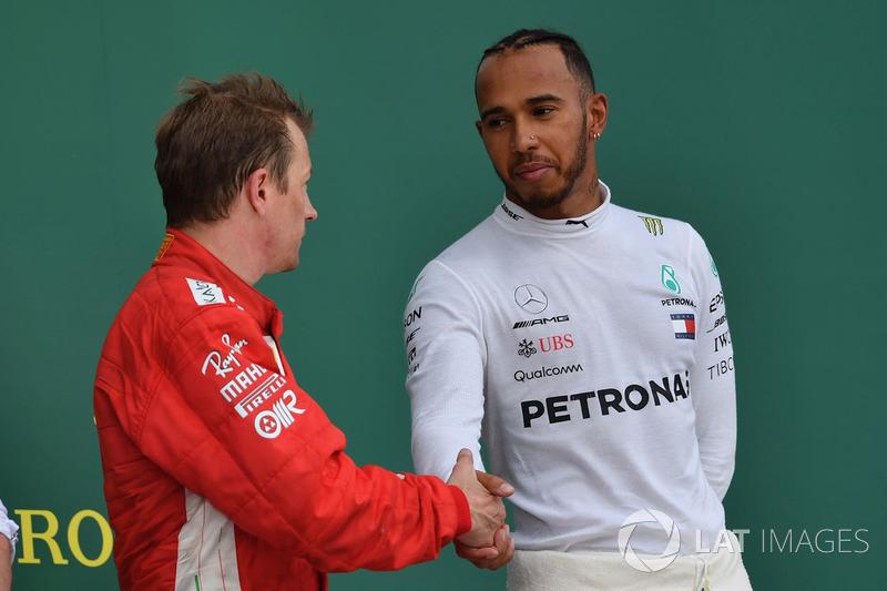 Kimi Raikkonen, Ferrari and Lewis Hamilton, Mercedes-AMG F1 celebrate on the podium