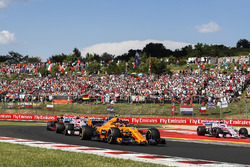 Stoffel Vandoorne, McLaren MCL33, leads Esteban Ocon, Force India VJM11, and Daniel Ricciardo, Red Bull Racing RB14
