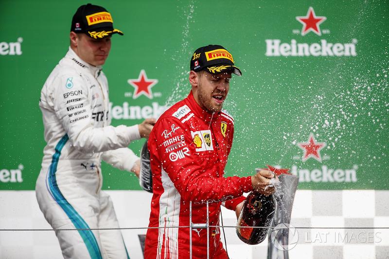 Valtteri Bottas, Mercedes AMG F1, 2nd position, and Sebastian Vettel, Ferrari, 1st position, celebra